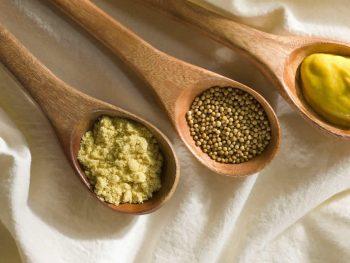 Mustard on wooden spoons